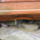 A crack is visible on the barge that slipped its mooring in Stamford on Wednesday morning and ran aground in Old Greenwich. No one was on board and there was no damage.