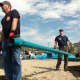Stamford firefighters, Capt. Jim Kelly, left, and Adam Fullilove, at right, help in playground building at West Beach Friday in honor of Jesse Lewis, one of the 20 students killed at Sandy Hook Elementary School.