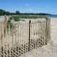 A fence around a sane dune at Sherwood Island State Park.