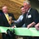Wilton First Selectman Bill Brennan, left, Peter Woods, President and CEO, Dorel Recreational/Leisure, center, and Norwalk Mayor Harry Rilling cut the ribbon at the grand opening of Cannondale Sports Unlimited's new headquarters in Wilton.