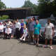 Norwalk representatives, STAR Inc. staff and STAR clients with the fleet of new vans purchased with a state grant.