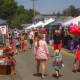 Shoppers enjoy a summer day in Wilton Center by checking out local businesses at the Wilton Street Fair.