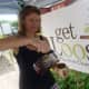 Lisa Feistel, of Westport, owner of Triangle Tea, pours some tea while at the Wilton Farmers Market.
