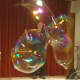Johnson creates large bubbles using a hula hoop at the New Canaan Library.