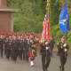 Wilton firefighters and police officers march in the tribute held Thursday morning in honor of those who died in the Sept. 11 attacks.