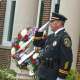 New Canaan Police Capt. Vincent DiMaio, salutes during the New Canaan 9/11 ceremony.