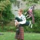 "Bagpiper Stephanie Moore of the New Canaan Volunteer Ambulance Corps plays ""Amazing Grace."""