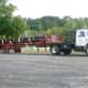 A truck with a load of pipe for the Yankee Gas natural gas pipeline project waits to be unloaded Monday.