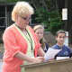 Our Lady of Fatima School Principal Martha Reitman speaks at a 9/11 Memorial Service.