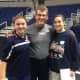 Wilton eighth-graders Bridgette Wall and Kaitlin Reif pose with UCONN women's basketball coach Geno Auriemma.
