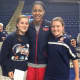 Kaitlin Reif and Bridgette Wall pose with Maya Moore, a UCONN women's basketball player.