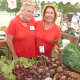Gretchen DeMattia, left, and Florine Kruger, are two of the many volunteers at Wilton's Ambler Farm fall festival on Sunday.