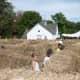 Children walk through the maze at the Ambler Farm fall festival.