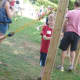 Zachary Northway, 4, of Wilton prepares to launch an apple by a slingshot Sunday at the Ambler Farm fall festival.