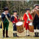Eric Lichack's Ministers of Apollo, professional Colonial re-enactors, attend a recent fife and drum corps parade. From 11 a.m. to 3 p.m. Saturday on the New Canaan historical society grounds a Colonial Day event will be held the society's 125 years.