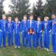 Danbury High School's boys cross country team shows its FCIAC championship trophy.