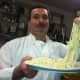 Executive chef and co-owner Antonio Perillo, holds up some of his freshly made spaghetti at his new Georgetown restaurant, Aranci 67.
