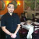 Paolo Perillo, manager of the family owner Aranci 67, stands in the dining room of the 7 Main St., Georgetown restaurant.