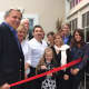 The Wilton Chamber of Commerce welcomed new restaurant Aranci 67 to the area at a grand opening recently. The restaurant is in Georgetown. Picture in front are co-owners Antonio (white shirt) and Julia Perillo (white scarf).
