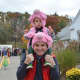 Harry Grand with his son, Win, following Bedford Village's Halloween Parade.