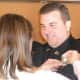 Newly promoted Wilton Police Sergeant David Hartman, smiles at his wife Lisa as she pins his sergeant badge on during a ceremony at the Town Hall Annex Monday.