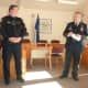 Wilton Police Chief Michael Lombardo, at right, speaks during the promotion ceremony for Sgt. David Hartman Monday at the Town Hall Annex.