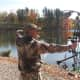 Dean Renzi displays his bow hunting form near Silver Lake in North Castle.