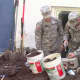 Cadets from West Point work on one of the high street homes