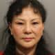 Hui Min Lu, 53, of Flushing, N.Y., is charged with prostitution and practicing massage therapy without a license. Polices