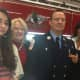 Newly promoted Wilton Fire Department Lt. Jeffery Locher with, from left daughter Jacqueline, sister Melinda Locher McCreary and his wife Tracy. He was sworn in on Monday.