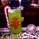 River Roadhouse' The Grinch, Midori melon liqueur, pineapple juice and coconut vodka served over ice in a highball glass.