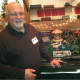 """Jon Perelstein, of Stamford, is one of the volunteer """"trainmen"""" who set up and organized the Great Trains Exhibit at the Wilton Historical Society. The event runs until Jan. 19."""