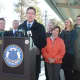 Flanked by state representatives at Stamford's Springdale station, Gov. Dannel P. Malloy announces new M-8 cars have begun operating on the New Canaan Branch.