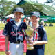 Weston resident, Sam Hensinger, 10, and Wilton resident, Chris Jones, 11. first met on a baseball field in Hong Kong. Here they are pictured in the Philippines for a baseball tournament.