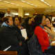 New Rochelle residents listen at Thursday's school district budget meeting.