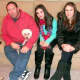 Glen Hochman, 52, with two of his three daughters and two of their three dogs.