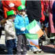 Parade viewers get into the spirit of St. Patrick's Day at a previous Stamford parade. The parade Saturday, March 4 begins at noon.