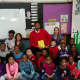 Mount Vernon Superintendent of Schools Kenneth Hamilton read to students to conclude the week.