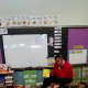 """Mount Vernon Superintendent Kenneth Hamilton reading """"One Fish, Two Fish, Red Fish, Blue Fish,"""" to students."""