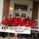 Employees of Keller Williams in Ridgefield celebrate the company's Day of Red on May 14.