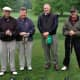Retired Stamford Probate Judge Gerald M. Fox, Jr. (second from left) who will be honored at the outing, with his golf foursome.