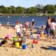 Families relaxing on a bright, sunny day at Weed Beach in Darien. Several Fairfield County communities, including Darien were named among the best suburbs in Connecticut to live in.