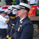 A trio of Ossining firefighters give salutes in the Katonah parade.