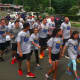 Runners in the Norwalk section of the Law Enforcement Torch Run on Friday morning.