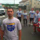 Sebastian Rojas, left, and his cousin, Norwalk Police Officer Phil Taborda along with other Norwalk Police Officers in the background participated in the Norwalk section of the Law Enforcement Torch Run.