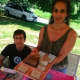 Lisa Sodaro and her son Jacob at their display at the Wilton Farmers Market. Sodaro owns Natural Herbal Creations.