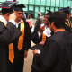 AITE students make some last-minute preparations before the graduation exercises.