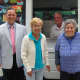 David Moore, vice president of Greenwich Bank and Trust, and Jack, from Polar Pete's Ice Cream, stand with River House members Margaret and Christina.