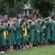 The graduates turn their tassels.