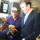 U.S. Sen. Chris Murphy, D-Conn., and Roger Frate, owner of Darien Seafood Market hold lobsters during a stop by Murphy Tuesday at Frate's business to talk about the health of the lobster industry.